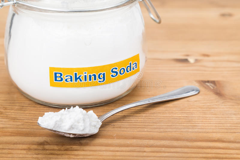 Jar and spoonful of baking soda for multiple holistic usages.  stock images