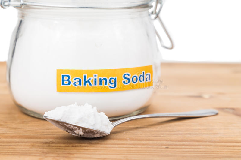 Jar and spoonful of baking soda for multiple holistic usages.  stock photo