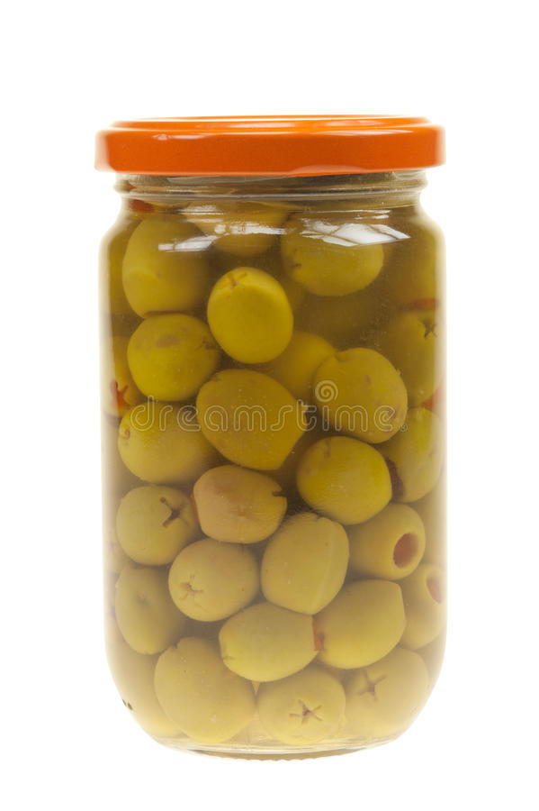 A jar of stuffed green olives isolated stock image