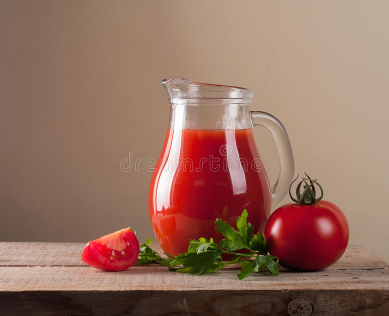 Jar with tomato juice stock images