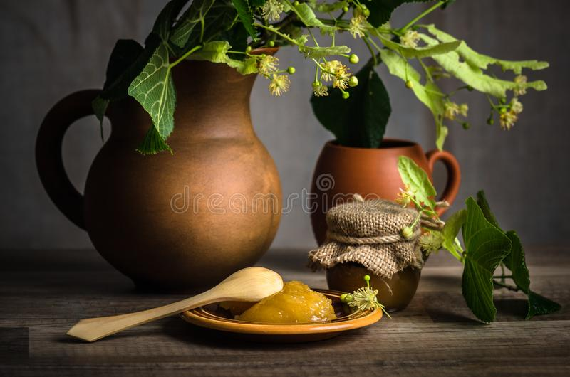 Jar with white honey on the table,nclose-up stock images