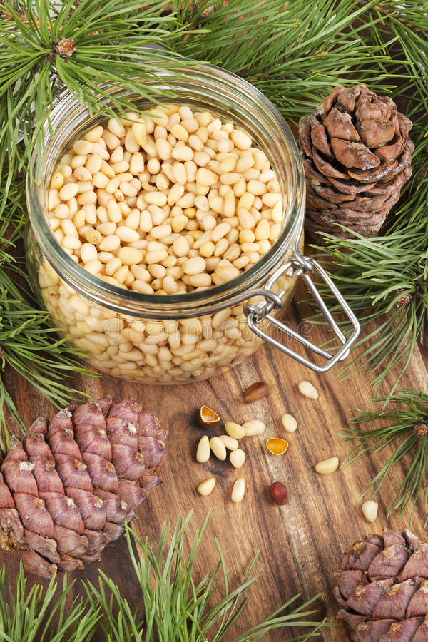 Free Jar With Pine Nuts On A Rustic Wooden Table Royalty Free Stock Image - 39039266