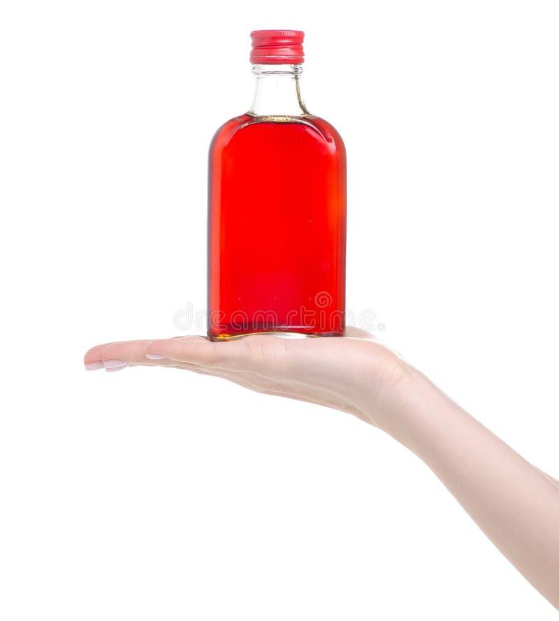 Jarabe del escaramujo de la botella a disposici?n fotografía de archivo
