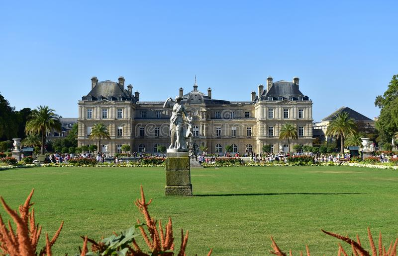 Jardin du Luxembourg, Gardens and Palace, Grass, flowers and statue, sunny day, blue sky. Paris, France, 15 August 2018. royalty free stock images