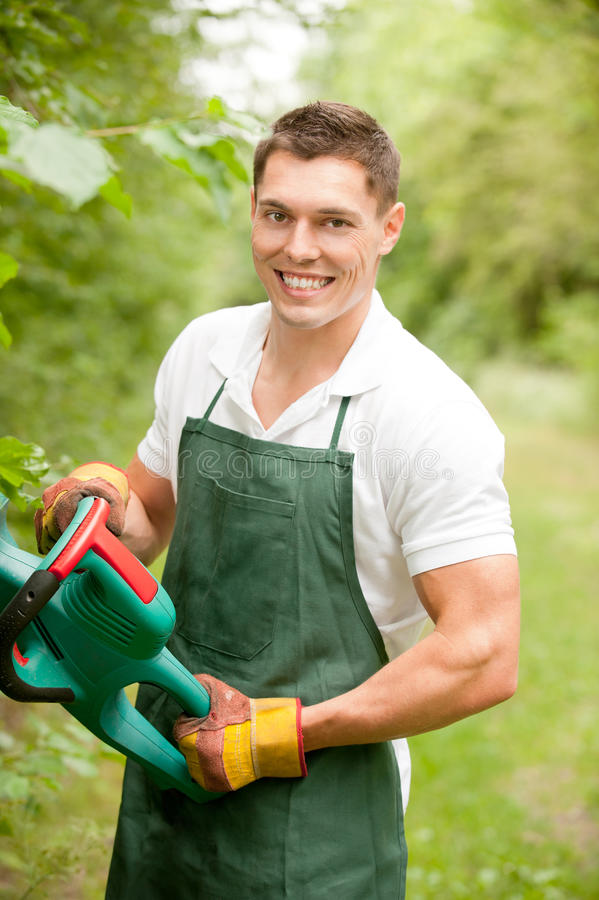 Jardineiro com ajustador de conversão fotografia de stock