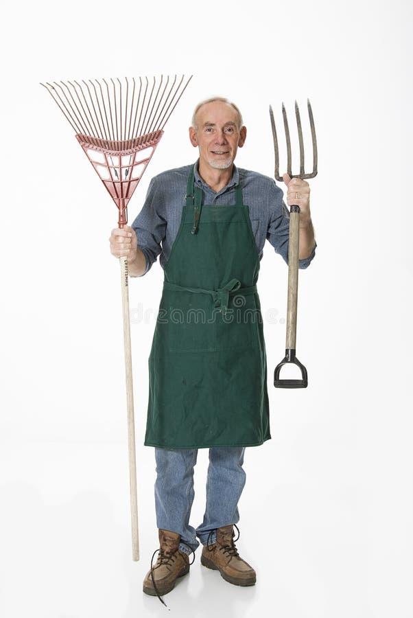 Jardineiro idoso com ferramentas imagem de stock royalty free