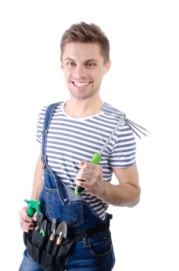 Jardineiro novo atrativo Indivíduo considerável que levanta com ferramentas fotos de stock royalty free