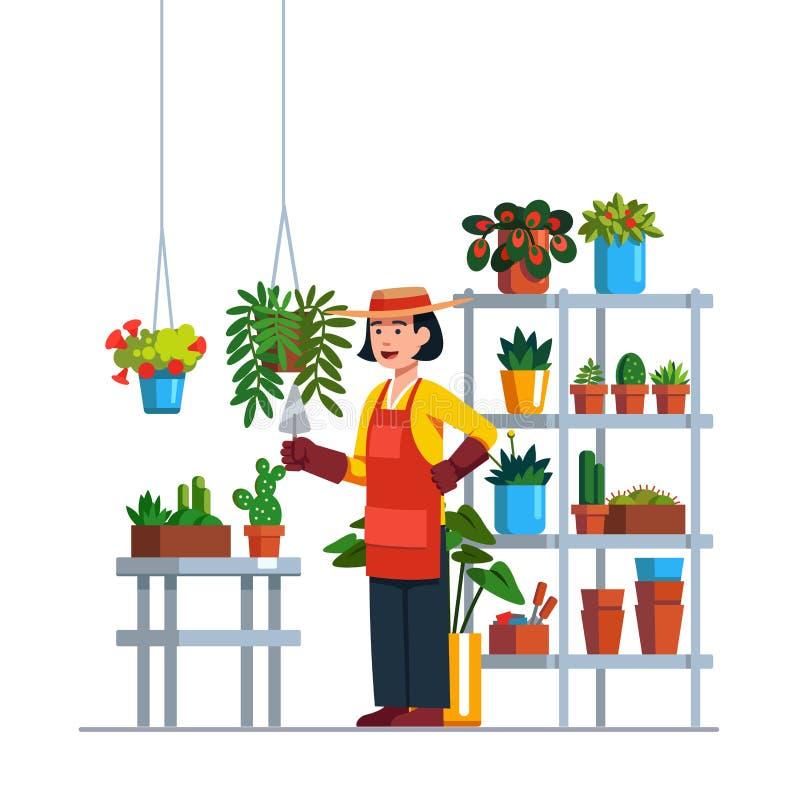 Jardinero de la mujer que trabaja en jardín botánico fotos de archivo libres de regalías