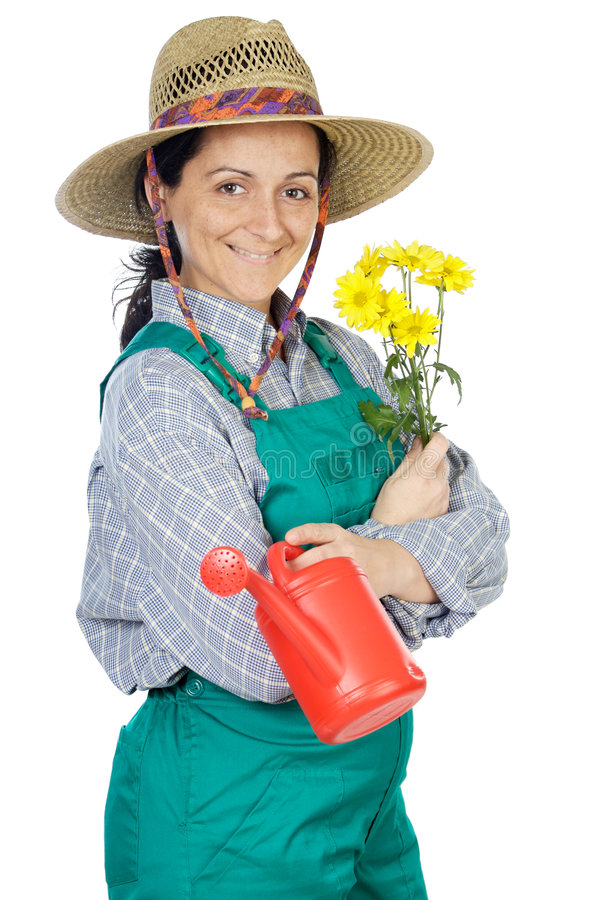 Jardinero vestido mujer feliz atractiva fotografía de archivo