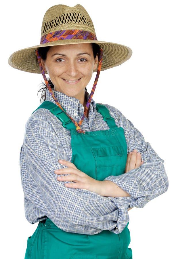 Jardinero vestido mujer feliz atractiva imagenes de archivo