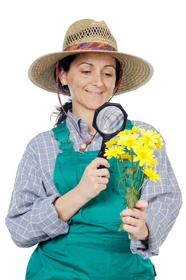 Jardinero vestido mujer feliz atractiva imágenes de archivo libres de regalías