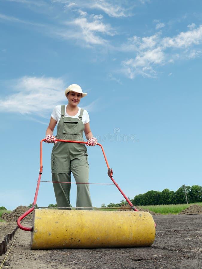 Jardinier et rouleau photos stock