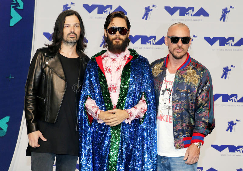 Jared Leto, Shannon Leto and Tomo Milicevic of Thirty Seconds to Mars. At the 2017 MTV Video Music Awards held at the Forum in Inglewood, USA on August 27, 2017 stock image