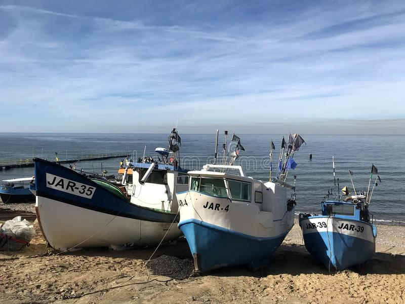 Fishing boats on the beach of Jaroslawiec Poland royalty free stock photography