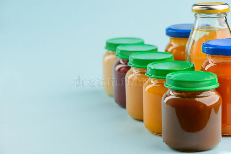 Jarred baby food and juice royalty free stock image