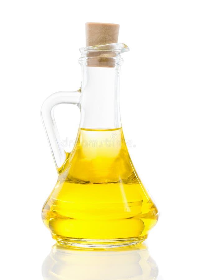 Jarro de cristal con el aceite vegetal imagen de archivo libre de regalías