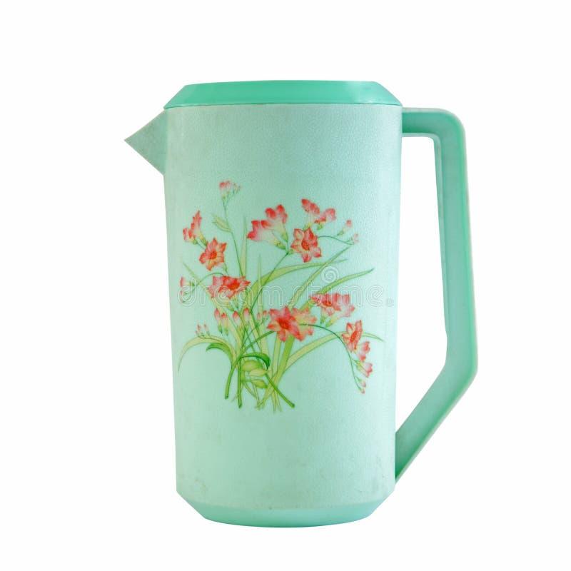 Jarro plástico verde com o teste padrão floral isolado fotos de stock royalty free