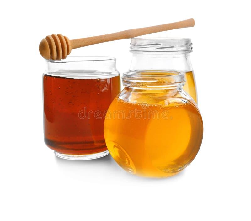 Jars with aromatic honey royalty free stock photos