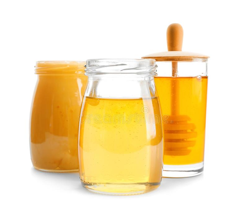 Jars with aromatic honey royalty free stock images