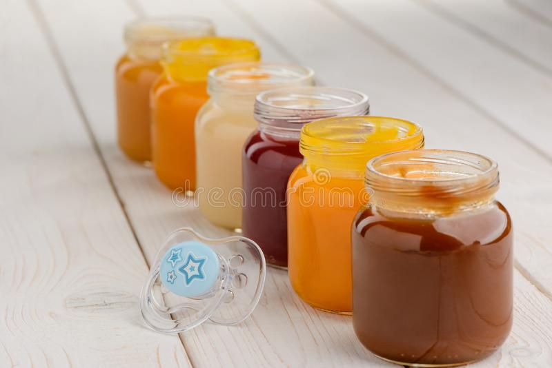 Jars of baby food stock images