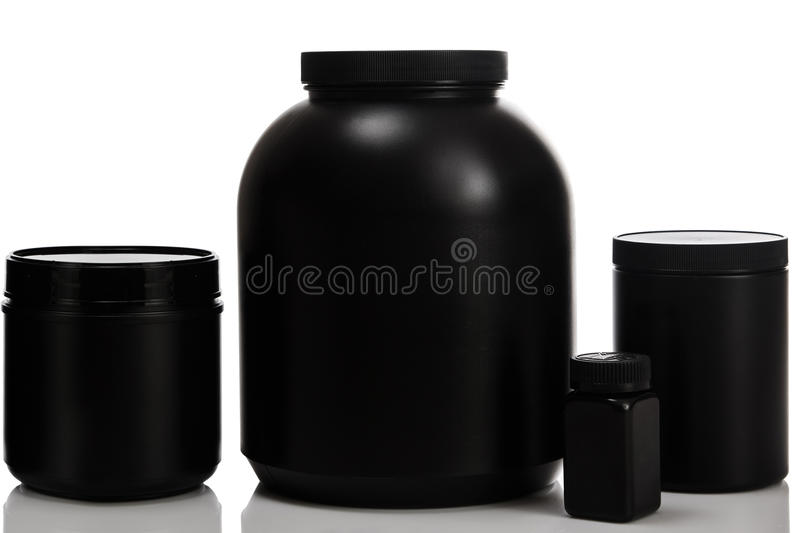 Jars with food supplements. Jars with different food supplements royalty free stock photography