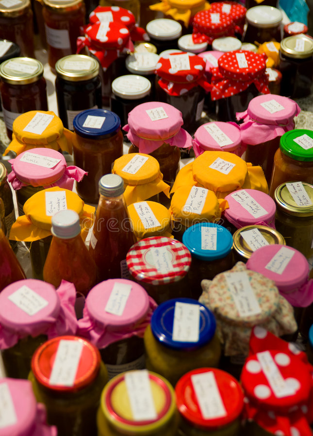 Jars of home-made preserves stock images