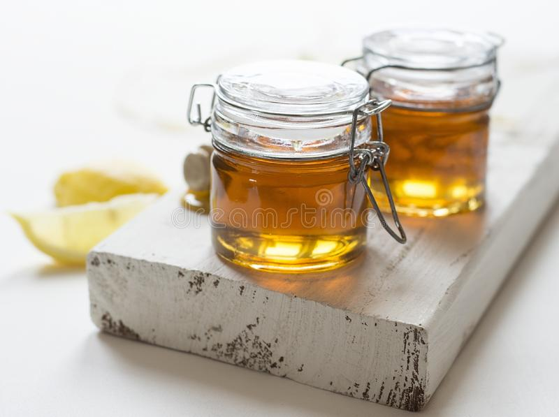 Jars of honey royalty free stock photos