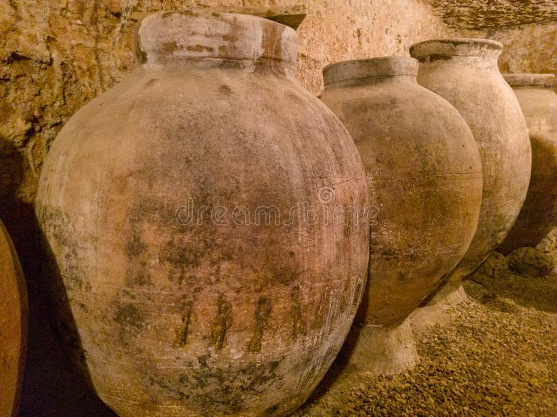 Jars inside a cave in Hita, Spain royalty free stock photography