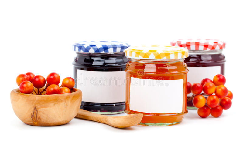 Jars of marmalade. With berry, on white background stock images