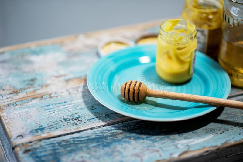 Jars with mustard and honey stock photography