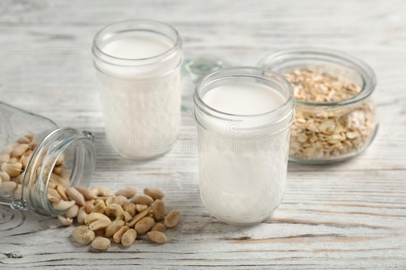 Jars with peanut and oat milk stock photos