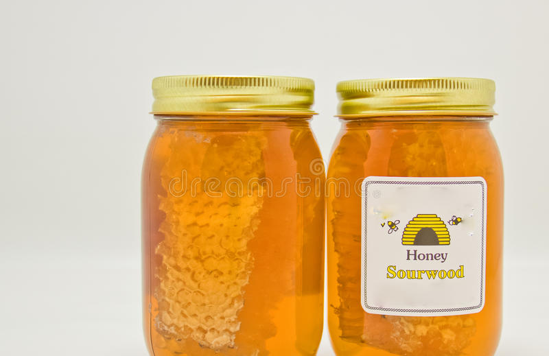 Jars of Sour Wood Honey stock images