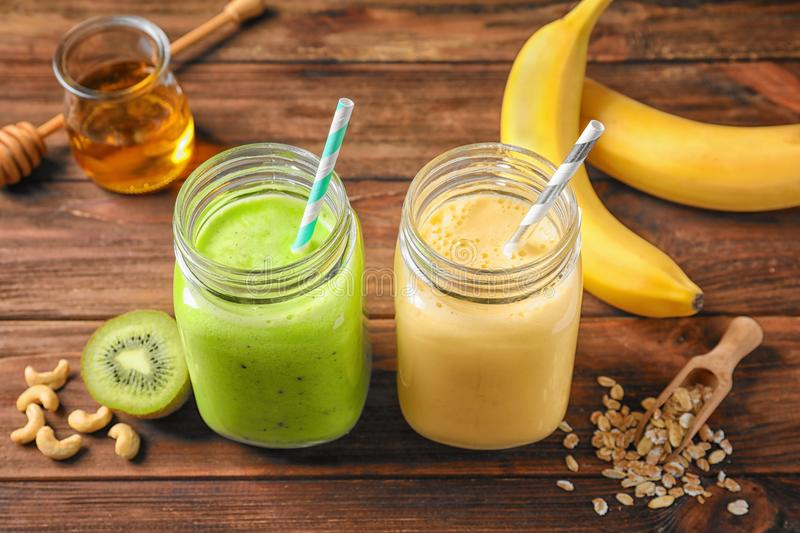 Jars with tasty protein shakes stock photography
