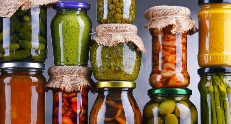 Jars with variety of pickled vegetables and fruits. Preserved food royalty free stock image