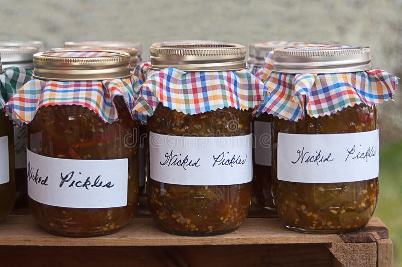 Jars of Wicked Pickle Relish. Jars filled with what is called wicked pickle relish royalty free stock image