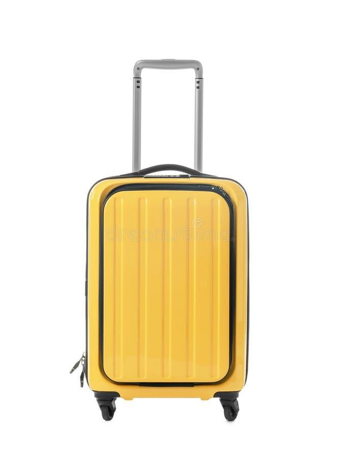 Jaskrawa żółta walizka na białym tle obrazy royalty free