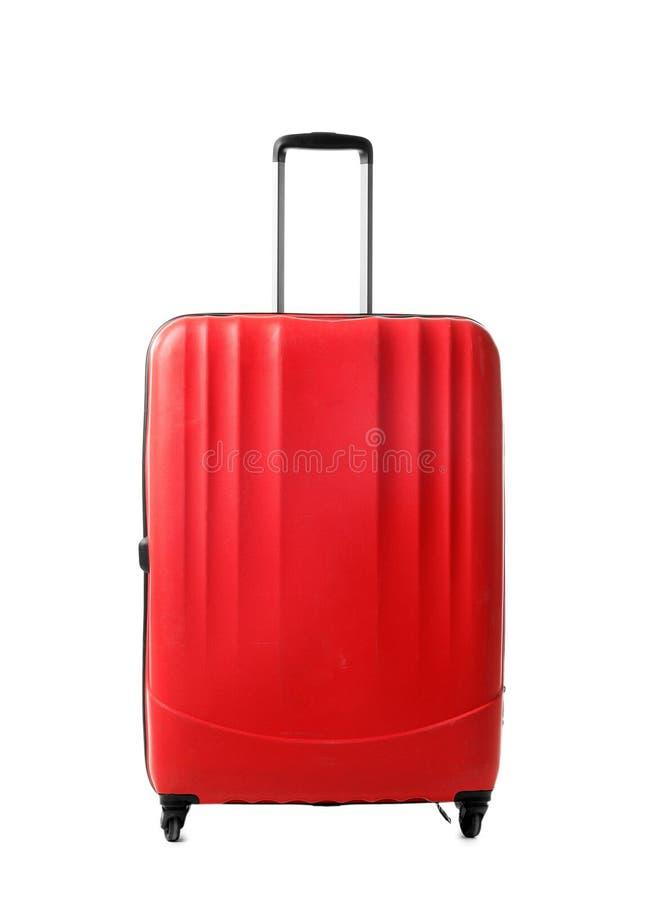 Jaskrawa czerwona walizka na białym tle fotografia royalty free