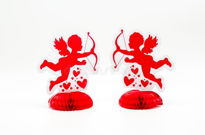 2 jaskrawej czerwonej amorek dekoraci stawia czoło each inny zdjęcia royalty free