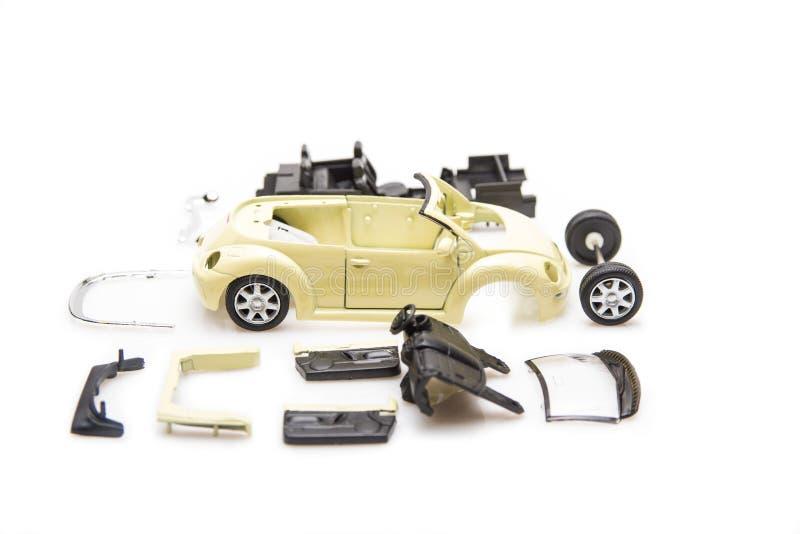 Jaskrawy wizerunek zabawkarskie samochodowe części odizolowywać obraz royalty free