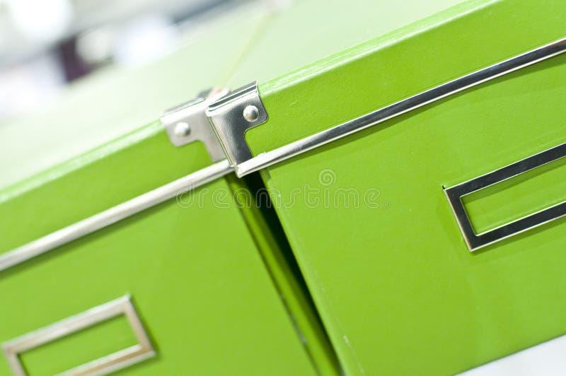 Jaskrawy - zieleni pudełka zdjęcie stock