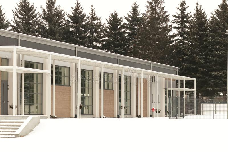 Jaslo, Poland - 2 2 2019: A modern one-story building among the winter nature. Exterior design glazed structure. Technology Art royalty free stock photo