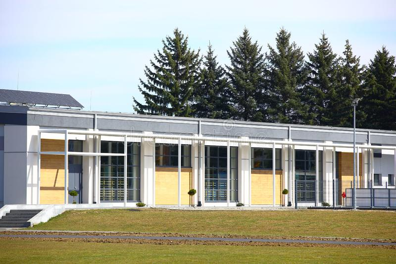 Jaslo, Poland - 9 3 2019: The modern sports hall of the village school. The eduction building of the younger generation. Walls stock photos