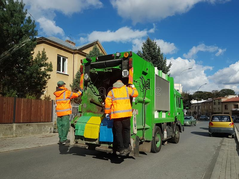 Jaslo, Poland - sept 09 2018: Collection and transportation of domestic garbage by municipal service employees. Control of the eco. Logical situation in cities stock image