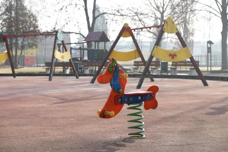 Jaslo, Poland - 9 2 2019: Swing in the form of a horse on a spring. Playground equipment. Multicolored wooden toys for children. And teenagers. Design of sports stock photo