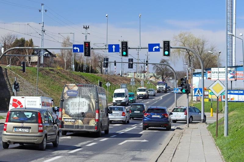 Jaslo/Yaslo, Poland - april 14, 2018: Urban traffic at the crossroads of one city. Cars and trucks. Crossroads signaling. Movement. On the car ring royalty free stock images