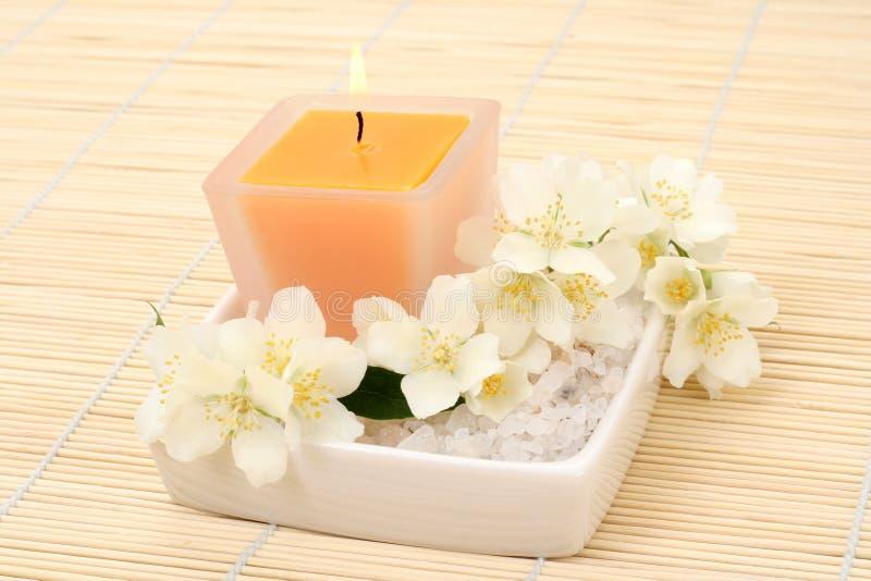 Jasmin aromatherapy. Aromatherapy - candle and fresh jasmin flowers stock photos