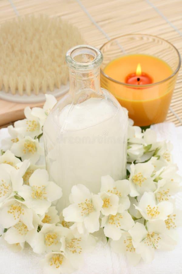 Jasmin bath. Beauty treatment - jasmin flowers and cosmetics royalty free stock photo