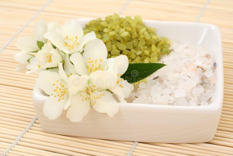 Jasmin bath. Beauty treatment - jasmin flowers and bath salt royalty free stock photos