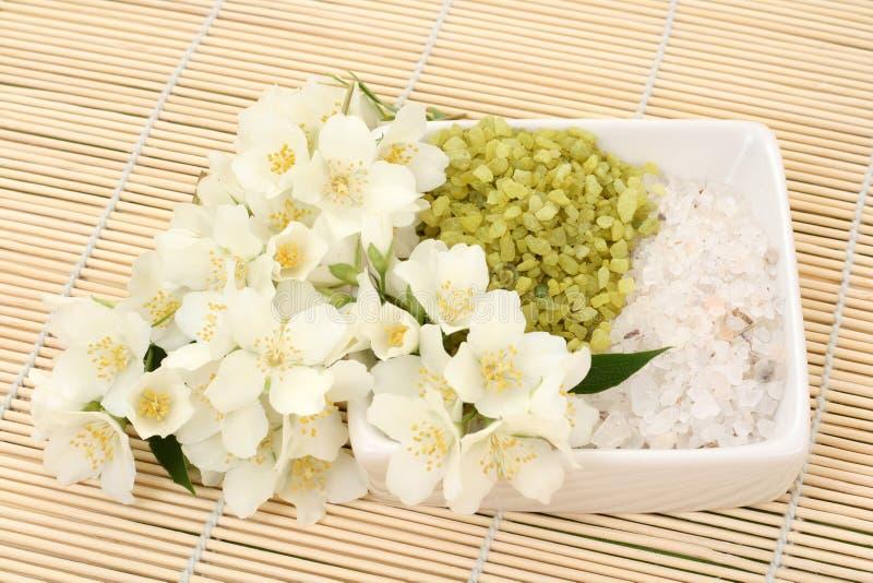 Jasmin bath. Beauty treatment - jasmin flowers and bath salt stock photography