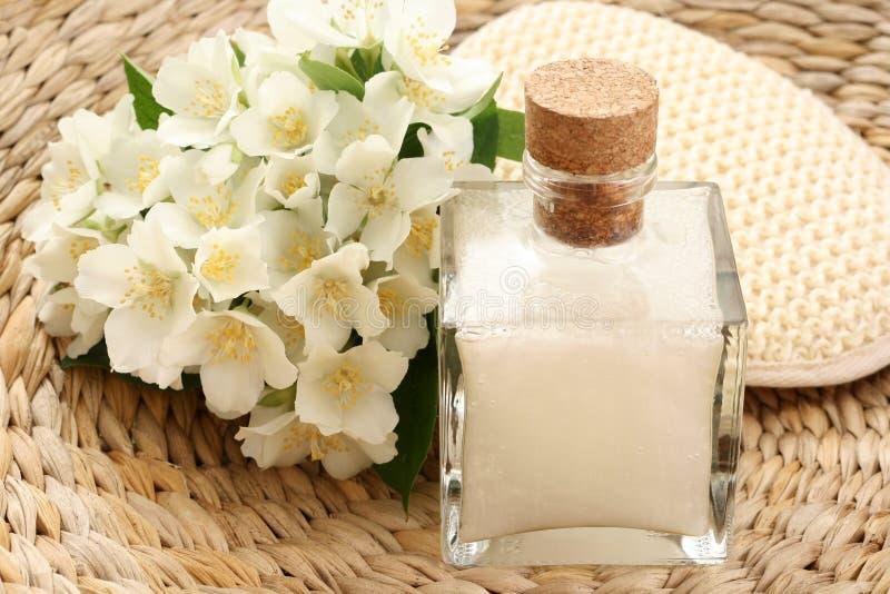Jasmin bath. Beauty treatment - jasmin flowers and cosmetics stock photo
